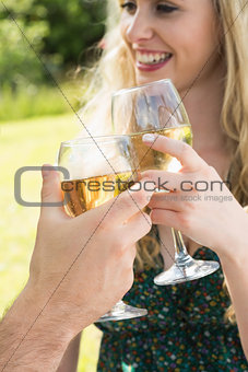 Woman clinking her glass with her boyfriend