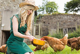 Young blonde feeding her chickens