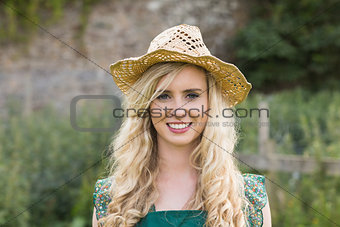Cute young woman wearing a straw hat