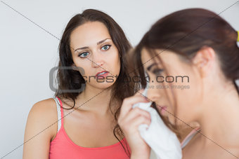 Crying woman sitting with her friend