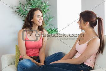 Two beautiful young women having a conversation
