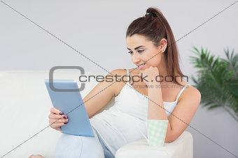 Beautiful young woman looking at digital tablet