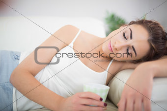 Beautiful exhausted woman holding a cup