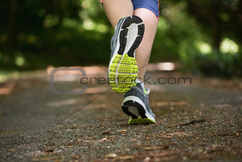 Woman jogging away from camera