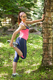 Young brunette woman stretching