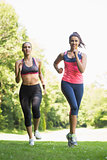 Two fit brunette women jogging