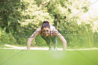 Fit young woman doing plank position