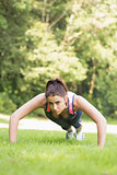 Focused fit woman doing plank position