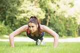 Serious fit woman doing plank position