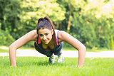 Smiling fit woman doing plank position
