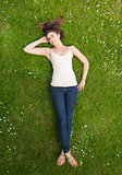 Pretty woman lying on a lawn