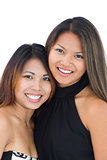 Two dressed up asian sisters posing for the camera