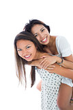 Cute woman giving her sister a piggyback ride