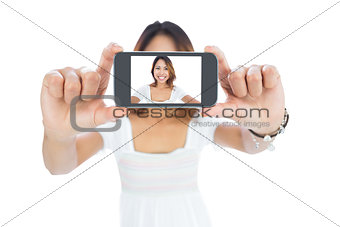 Happy asian woman taking a selfie