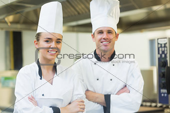 Two chefs smiling at the camera