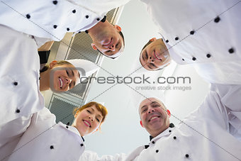 Five chefs standing in a circle