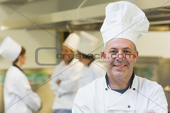 Mature male chef posing in a kitchen