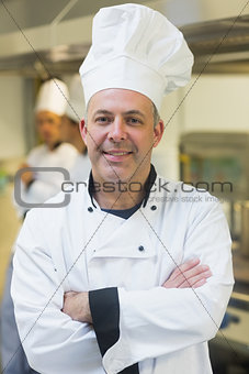 Proud mature chef posing in a kitchen