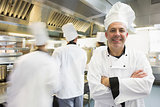 Head chef posing proudly in kitchen