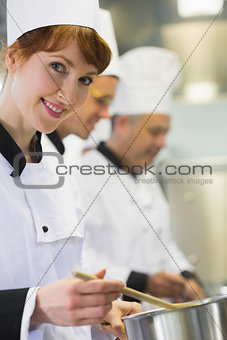 Young female chef smiling at the camera