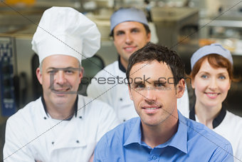 Young manager posing in a kitchen