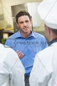 Young manager talking to the staff