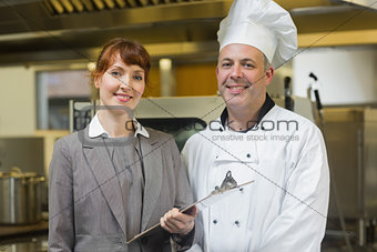 Mature head cook posing with the female manager