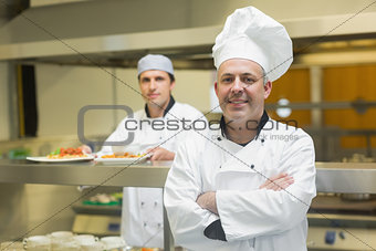 Mature chef posing proudly in a professional kitchen