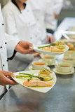 Chef holding salmon dish