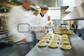 Four chefs working in a modern kitchen