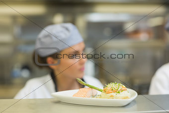 Salmon dinner on a plate on order station