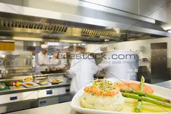 A plate with salmon asparagus and mashed potato