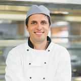 Handsome young chef smiling at camera
