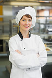 Pretty female chef posing in a modern kitchen