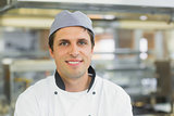 Happy male chef posing in a kitchen