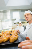 Young male baker standing in a bakery