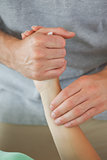 Physiotherapist feeling patients wrist