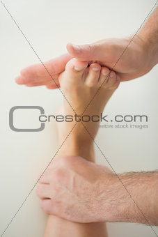 Close up of physiotherapist treating patients foot
