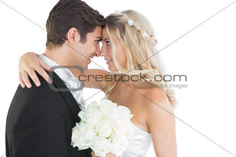 Beautiful young married couple looking each other in the face