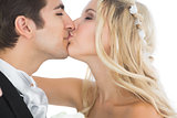Attractive married couple kissing each other