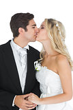 Young married couple posing kissing each other