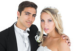 Young bridegroom posing with his wife