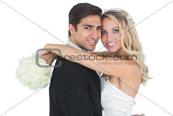 Beautiful bride embracing her husband