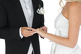 Bridegroom putting the wedding ring on his wifes finger