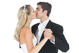 Young married couple dancing viennese waltz kissing each other