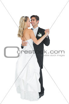 Cute young married couple dancing viennese waltz
