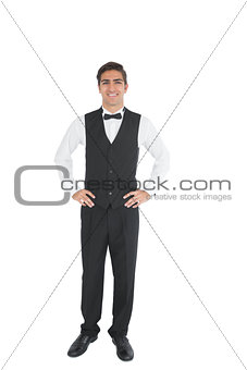 Attractive waiter posing with hands on hips