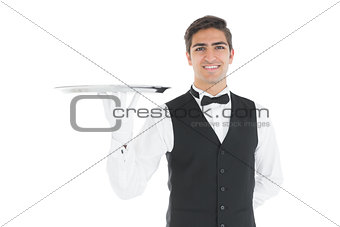 Attractive waiter presenting an empty tray