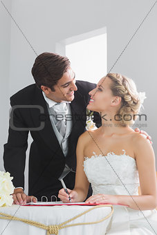 Beautiful blonde bride smiling at her husband
