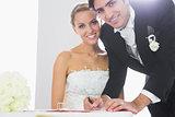Happy bridegroom signing wedding contract